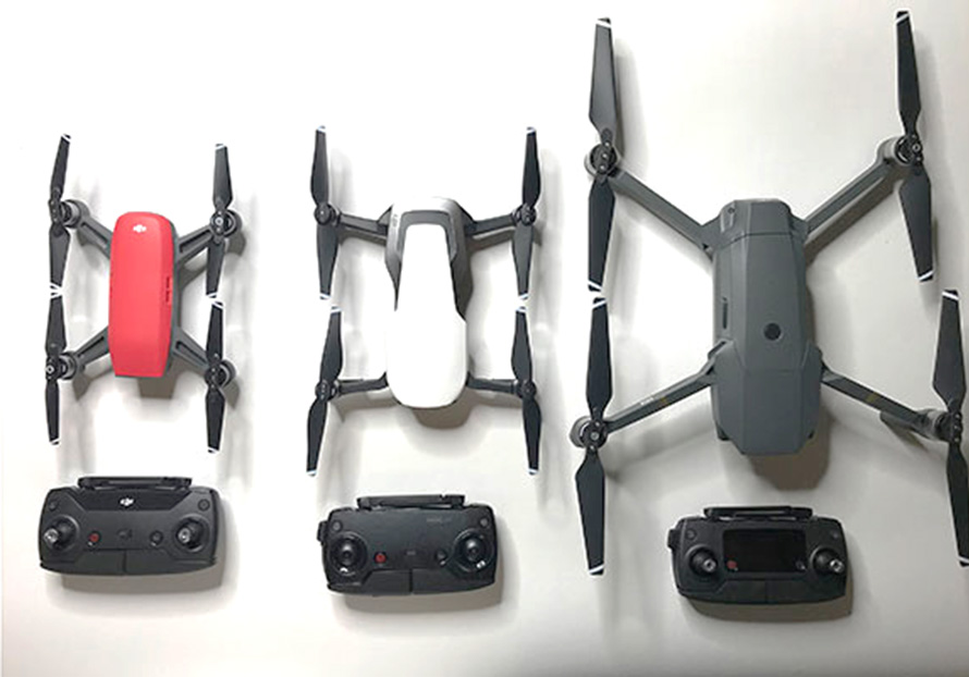 The Photo Above Shows Three Popular Small Sized Drones On Left In Red Is DJI Spark Center White Mavic Air