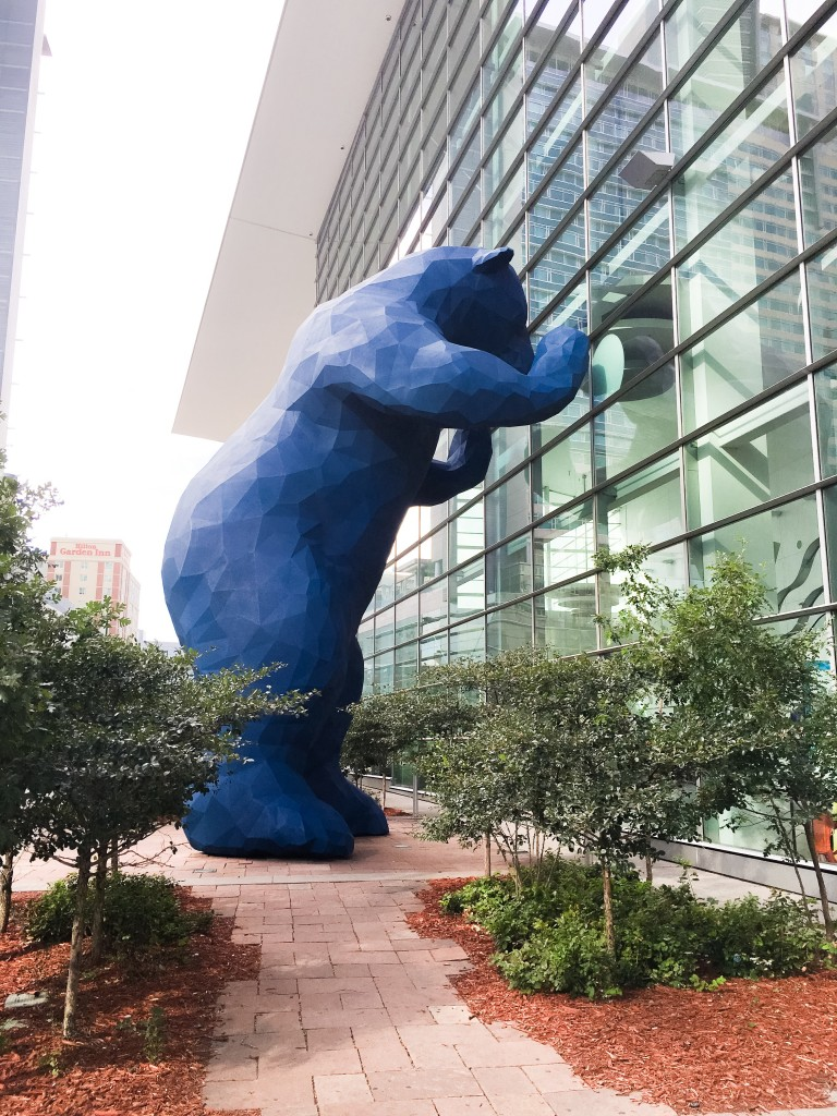 Enormous Blue Bear Statue gazes into 2nd story windows at the Colorado Convention Center